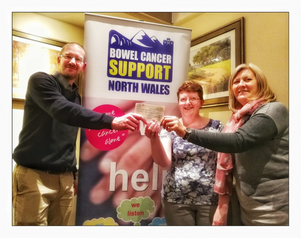 Receiving a cheque from Dan Hughes who completed a marathon in aid of the group.