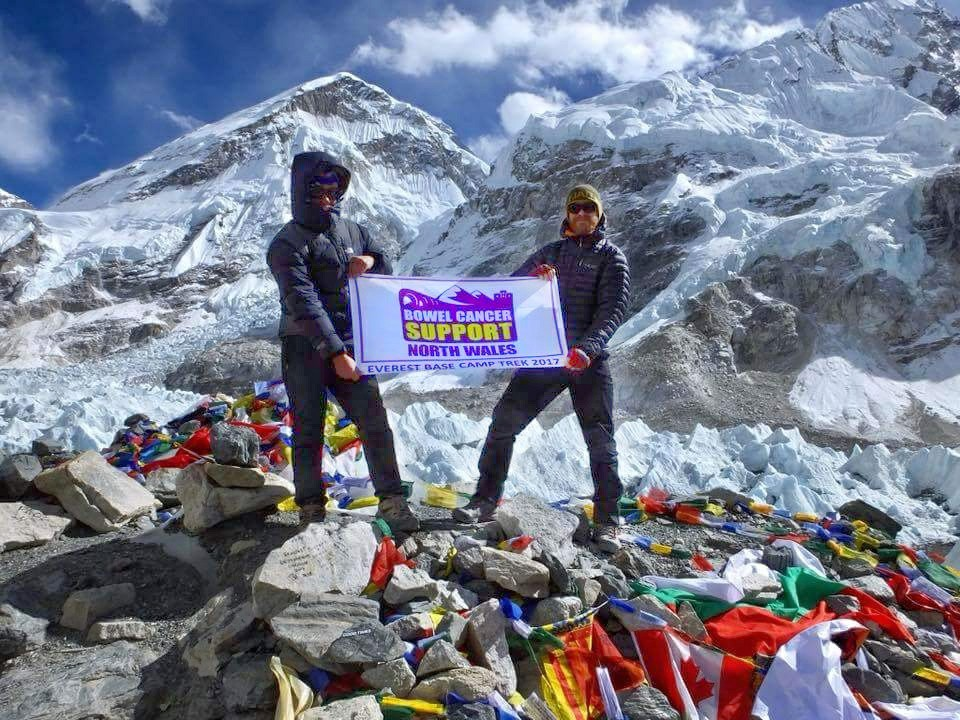 Gavin Mascall with our logo banner at Everest Base Camp